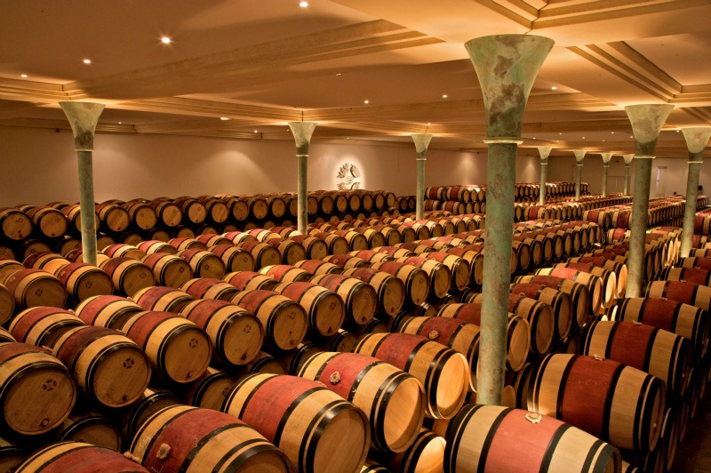 "Barrel cellar at Chateau Branaire-Ducru, St. Julien, Medoc, Bordeaux, France, member of ""Les Cinq"" group of wineries in Bordeaux"